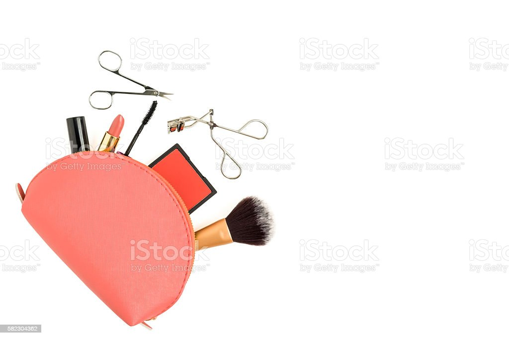 Isolated top view makeup items and bag stock photo