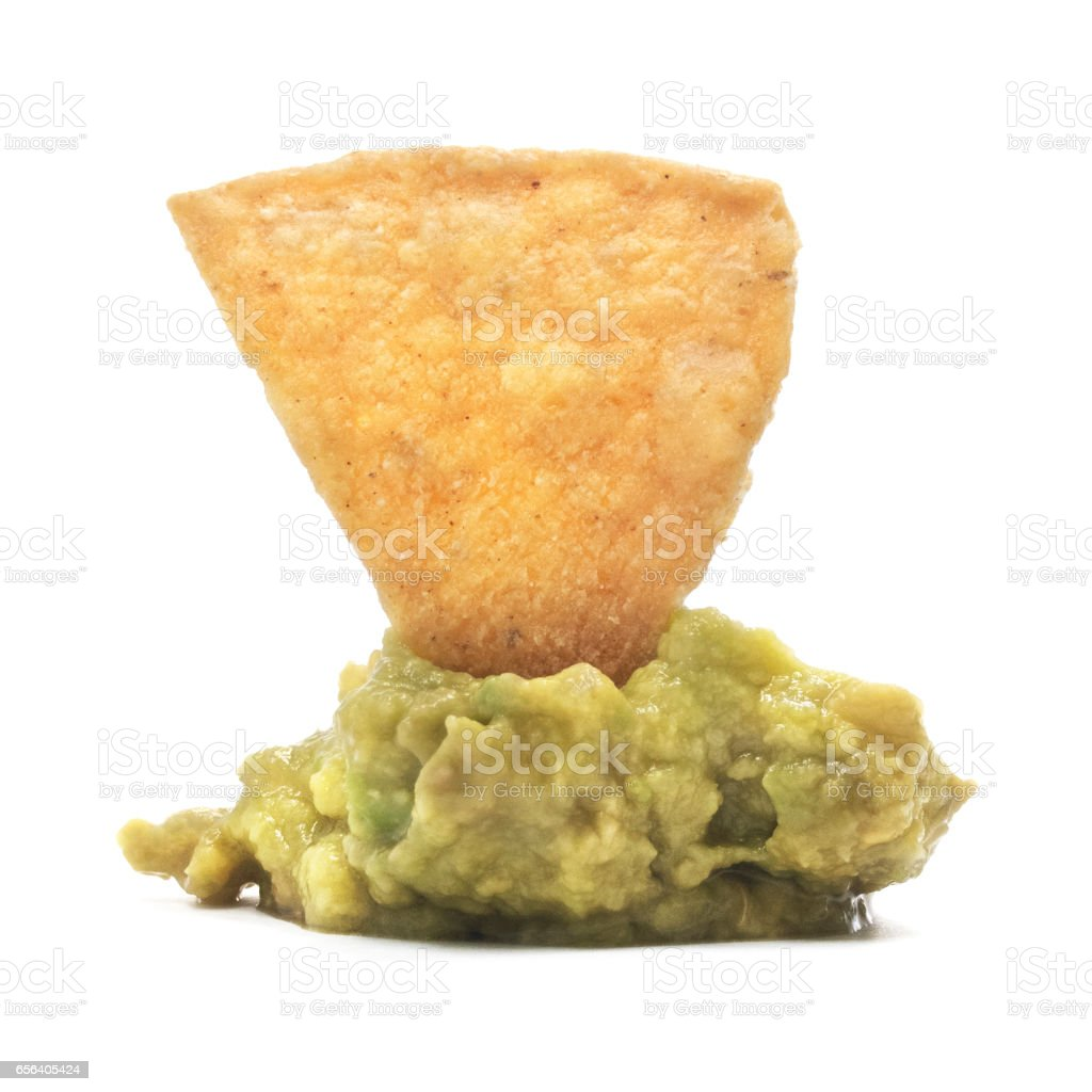 Isolated Tortilla Chip On Guacamole Dip stock photo