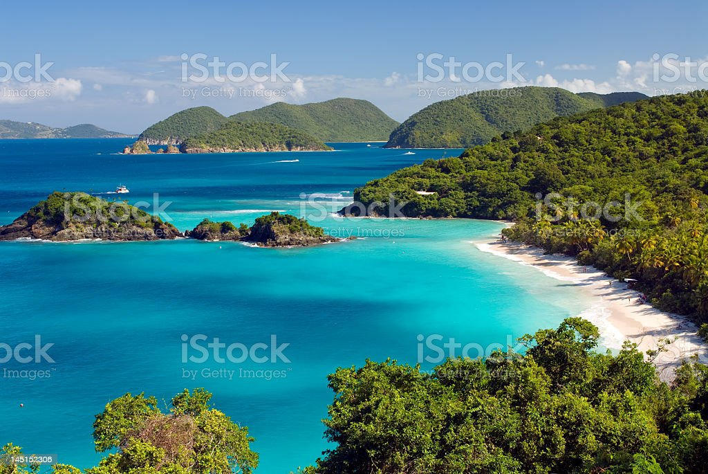 A isolated tropical beach with deep blue shores stock photo