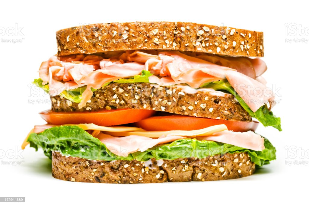 isolated turkey and ham sandwich stock photo
