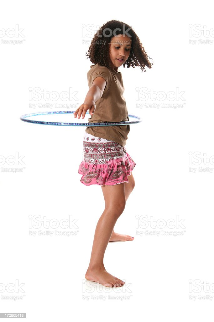 Isolated tween girl hula hooping on white background stock photo