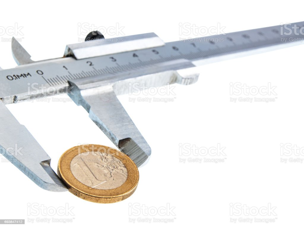 Isolated vernier caliper with a coin stock photo