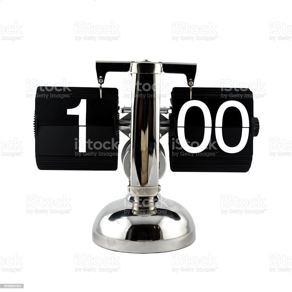 Isolated vintage flip clock at one o'clock stock photo