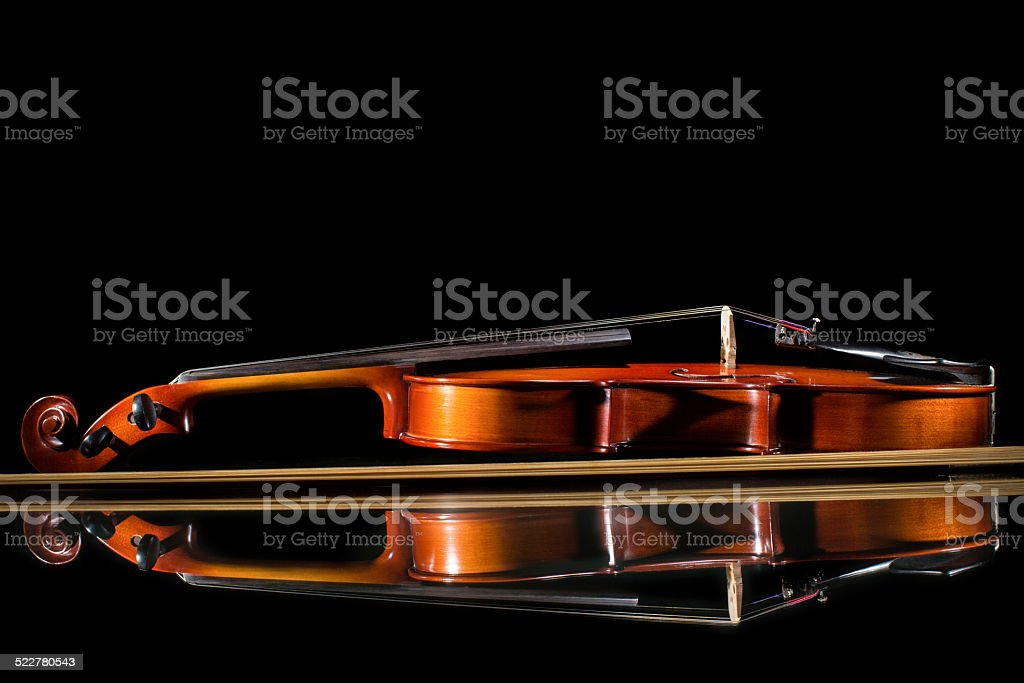 Isolated violin on black background stock photo