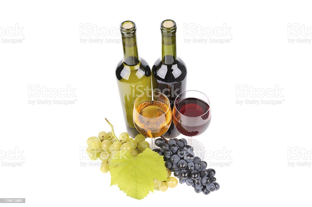isolated wine bottle with glass and green grapes royalty-free stock photo