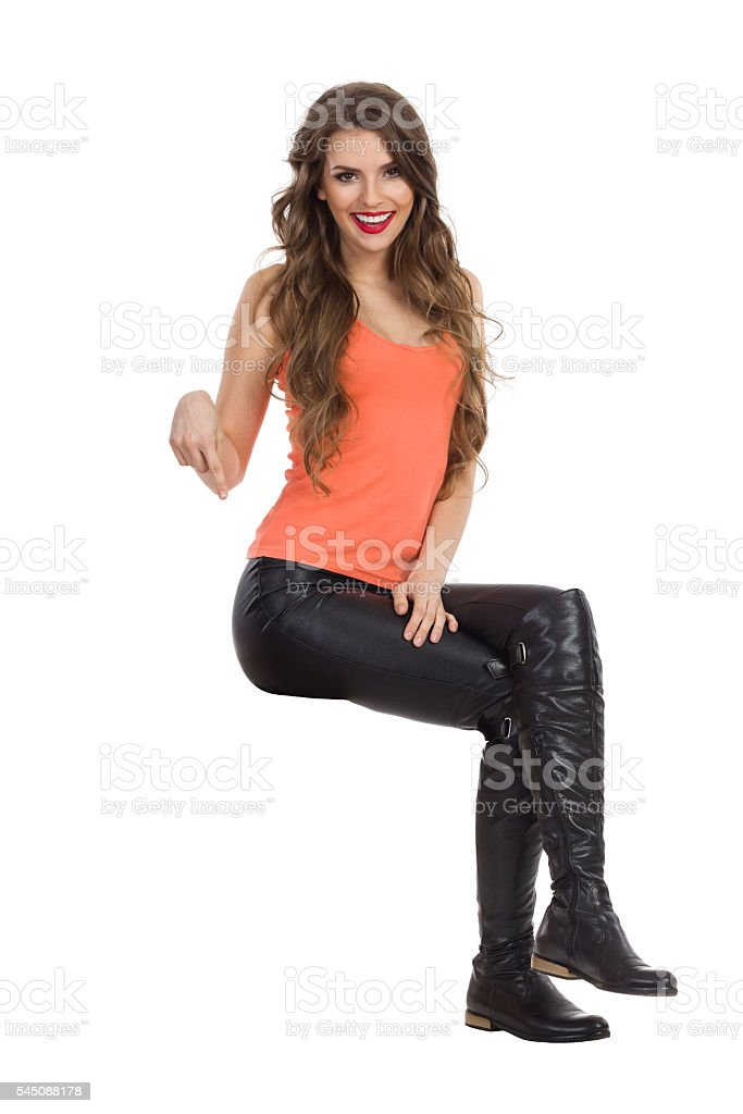 Isolated Woman Sitting And Pointing Down stock photo