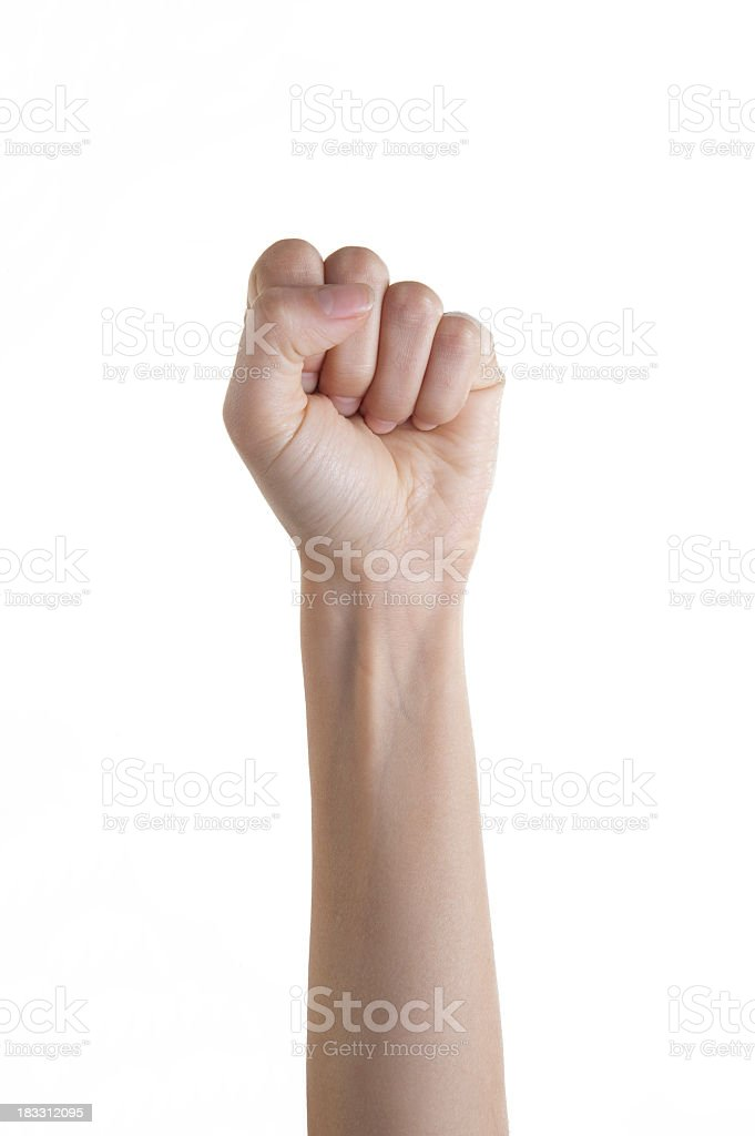 Isolated woman's fist punching upward stock photo