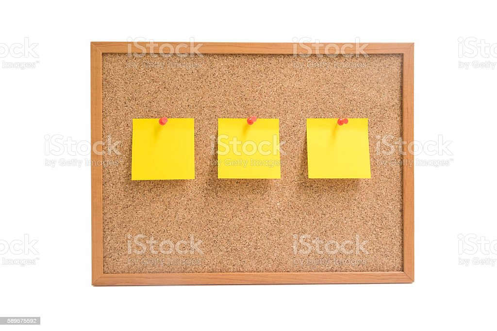 Isolated wooden board with three yellow sticky notes stock photo