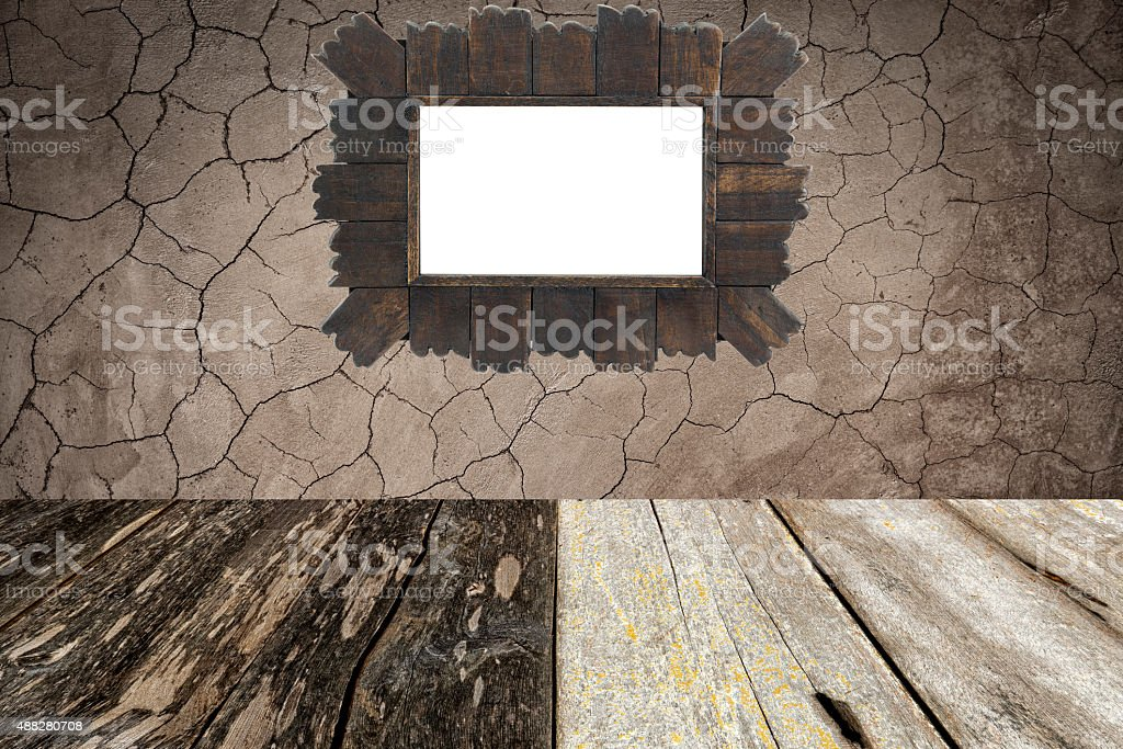 isolated wooden frame on grunge wall and wood floor. stock photo