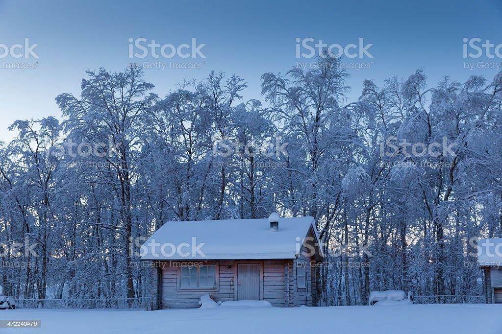 isolated wooden hut in remote arctic winter scene stock photo