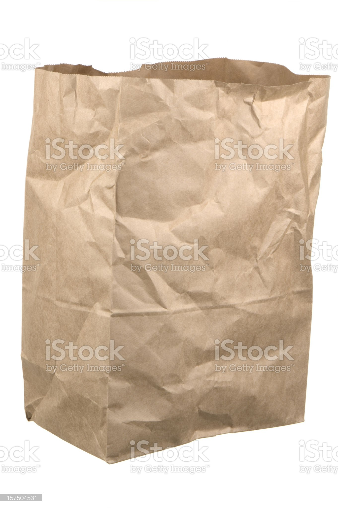 Isolated wrinkled empty brown grocery bag on white background royalty-free stock photo