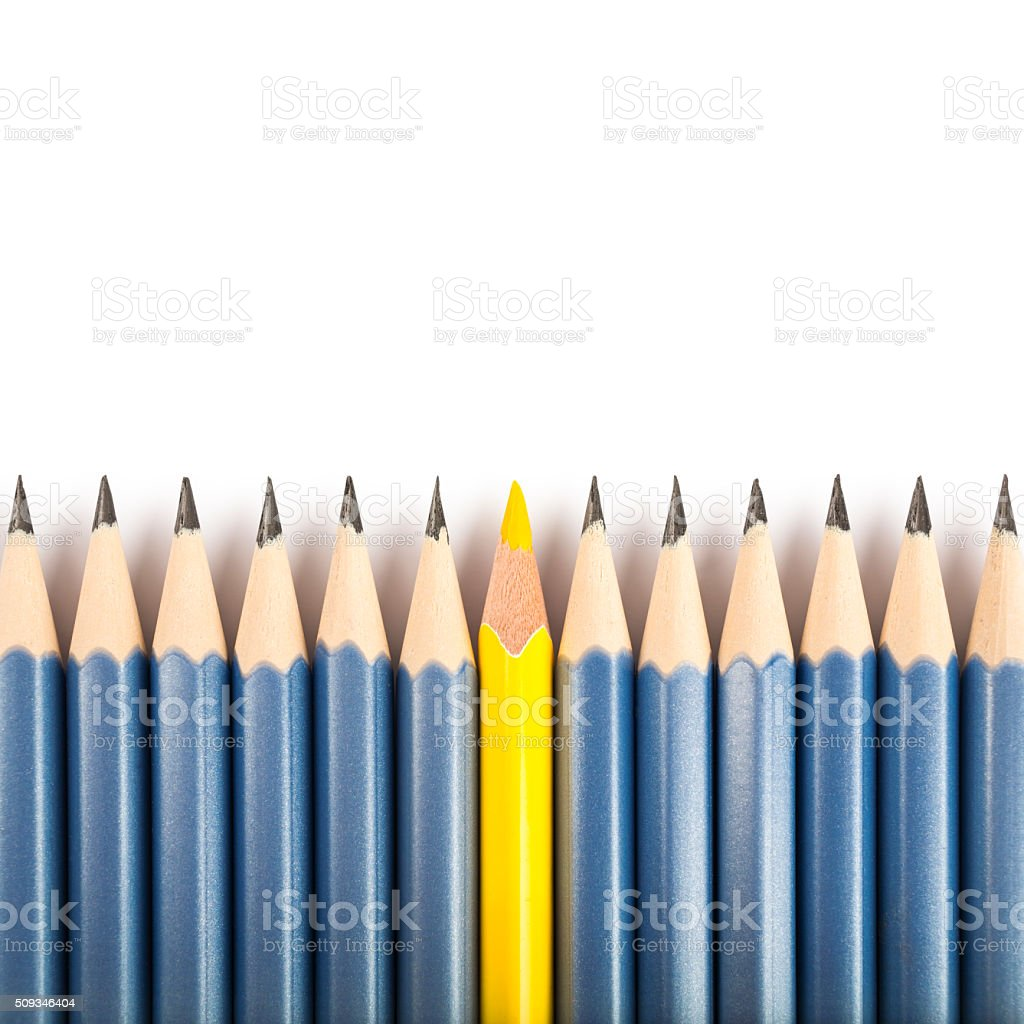 Isolated yellow pencil standing out from the crowd stock photo