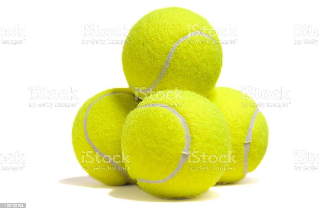 Isolated yellow tennis ball pyramid stock photo