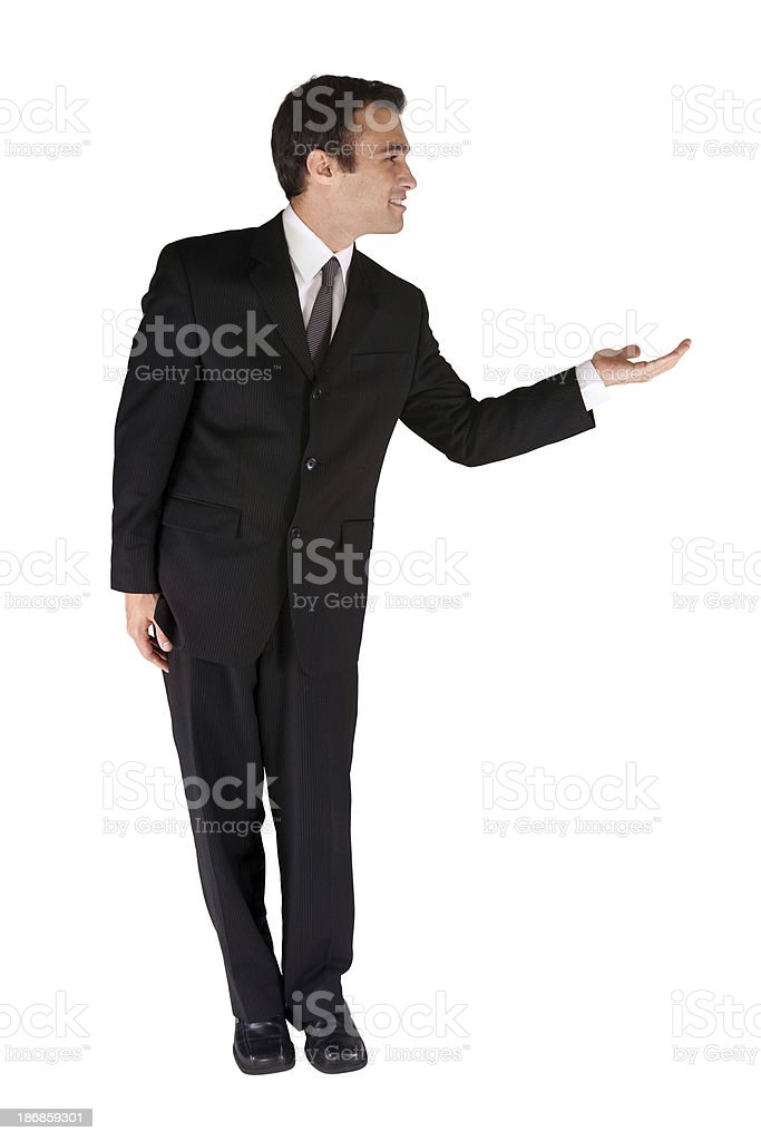 Isolated young businessman offering something royalty-free stock photo