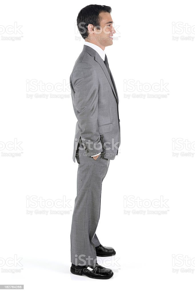 Isolated young businessman side view smiling royalty-free stock photo