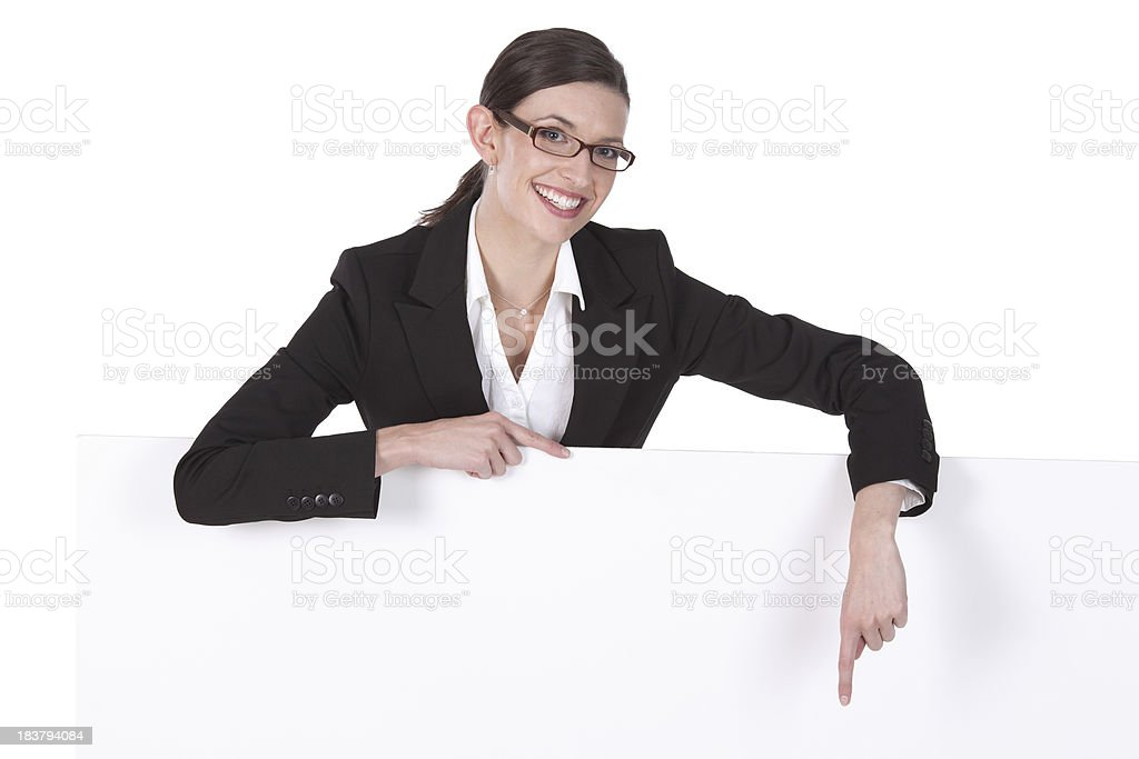Isolated young businesswoman wearing glasses standing behind sign royalty-free stock photo
