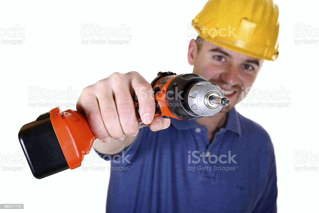isolated young manual worker with tool royalty-free stock photo