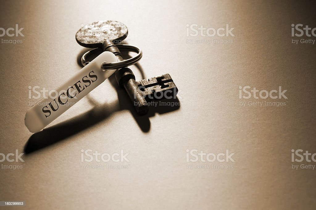 Isolates silver skeleton key with success ring on it stock photo