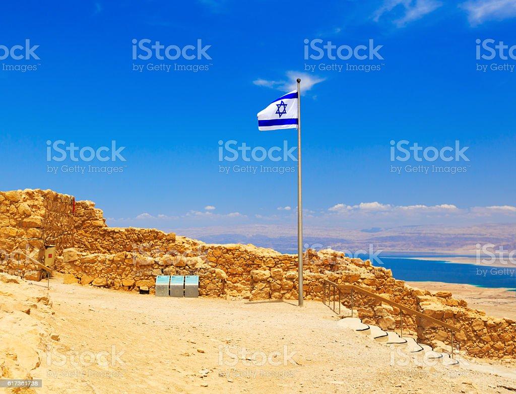 Israel flag in fortress Masada stock photo
