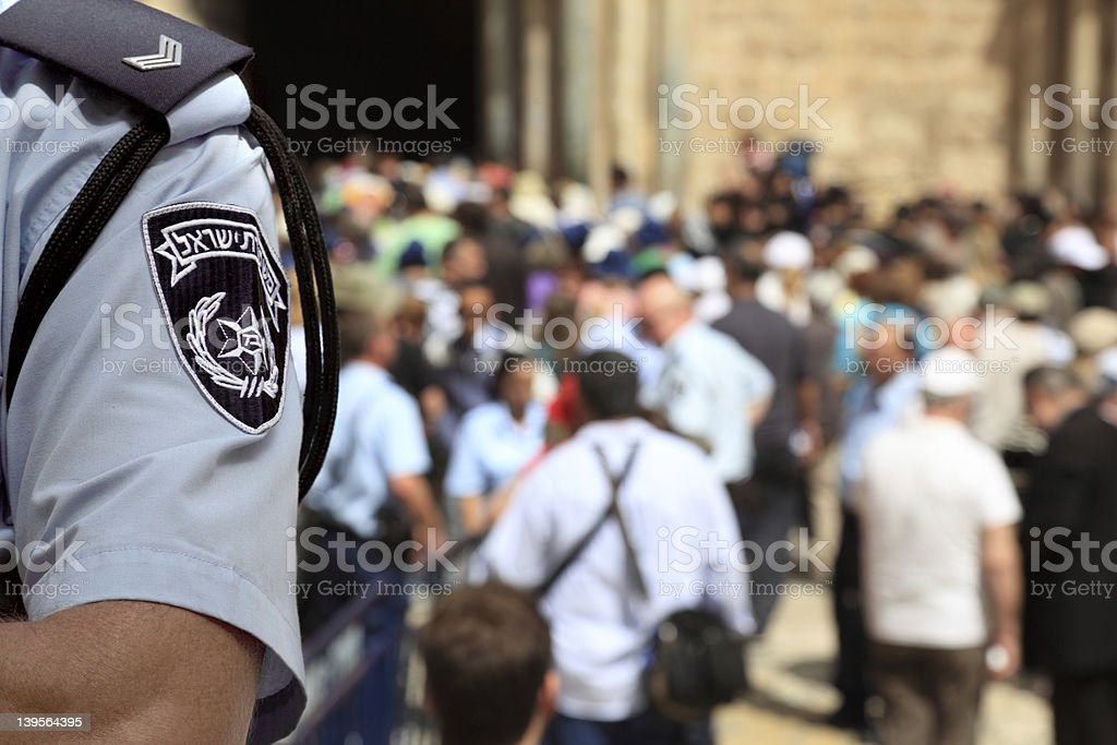 Israel Police Officer in the Crowded Street stock photo