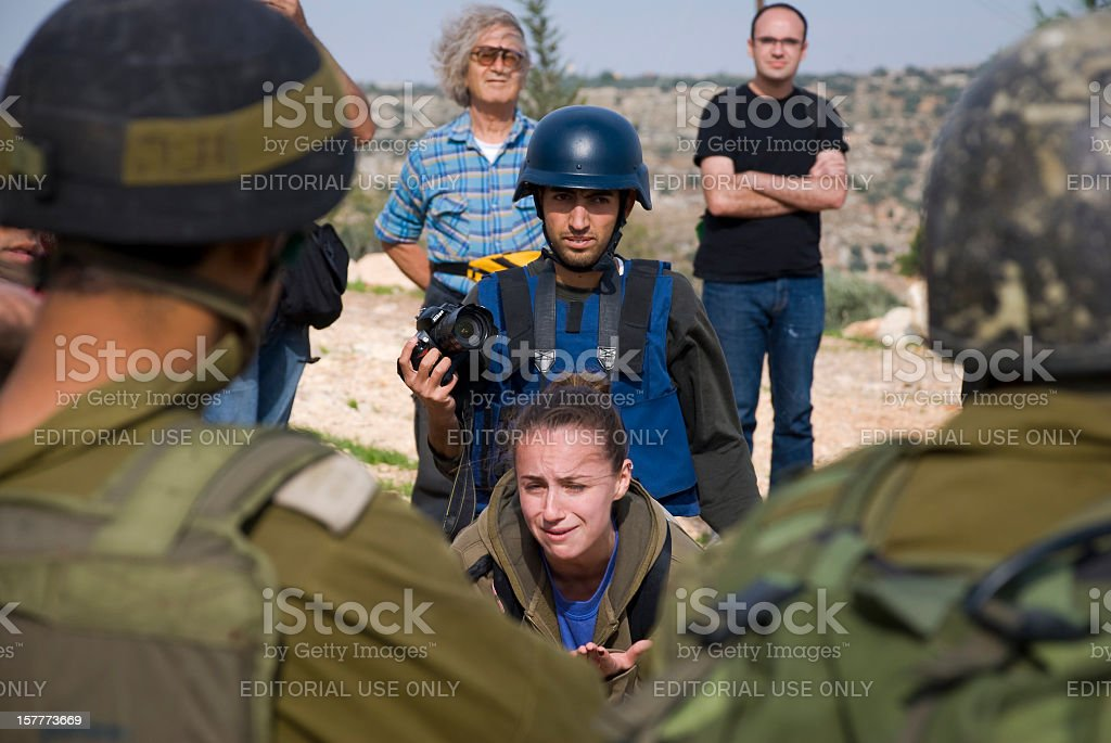 Israeli activist and soldiers in Bil'in, West Bank stock photo