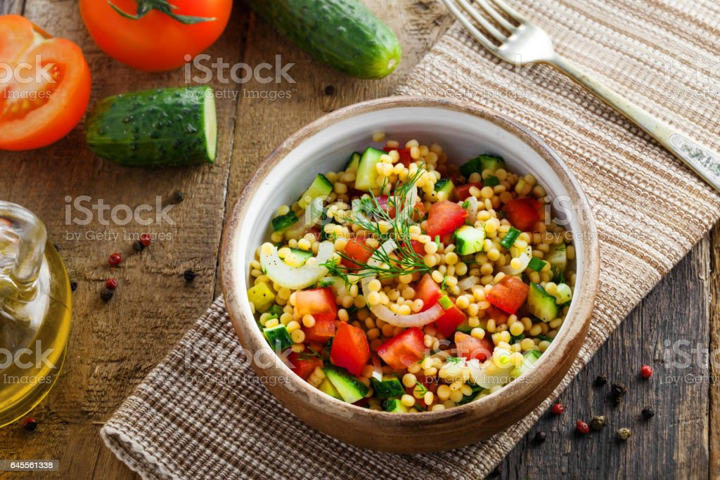 Israeli couscous Ptitim with vegetables stock photo