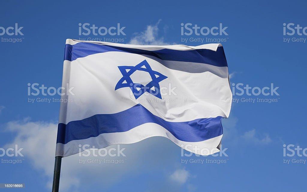 Israeli flag flying on a flagpole stock photo