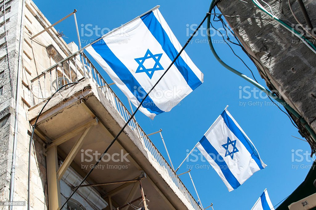 Israeli flag in street with blue sky stock photo