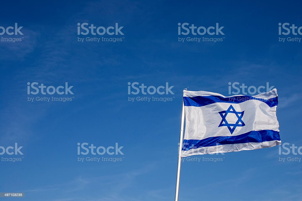 Israeli flag in strong wind stock photo