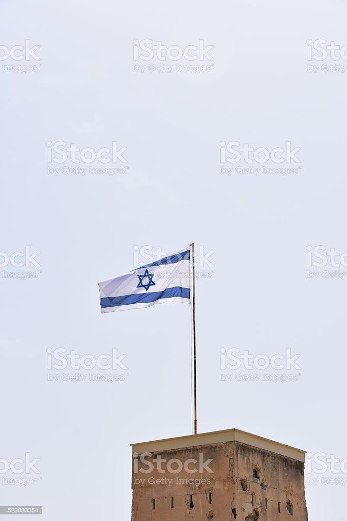 Israeli flag on the fortress of Latrun stock photo