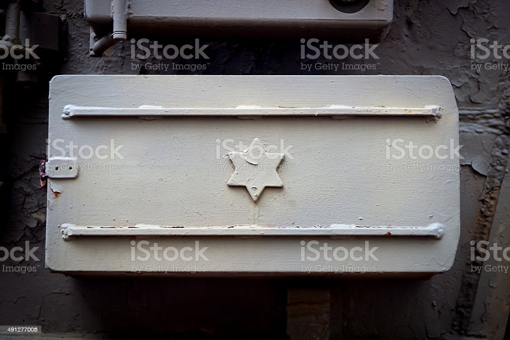 Israeli flag with the star of David, metal lid stock photo
