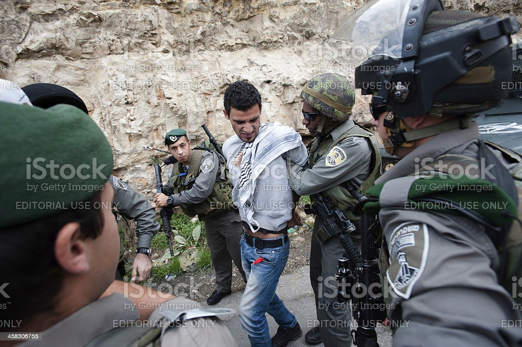 Israeli forces arrest Palestinian stock photo