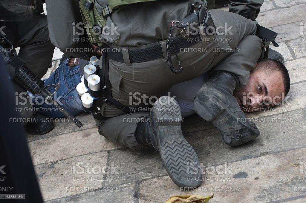 Israeli police arrest Palestinian stock photo