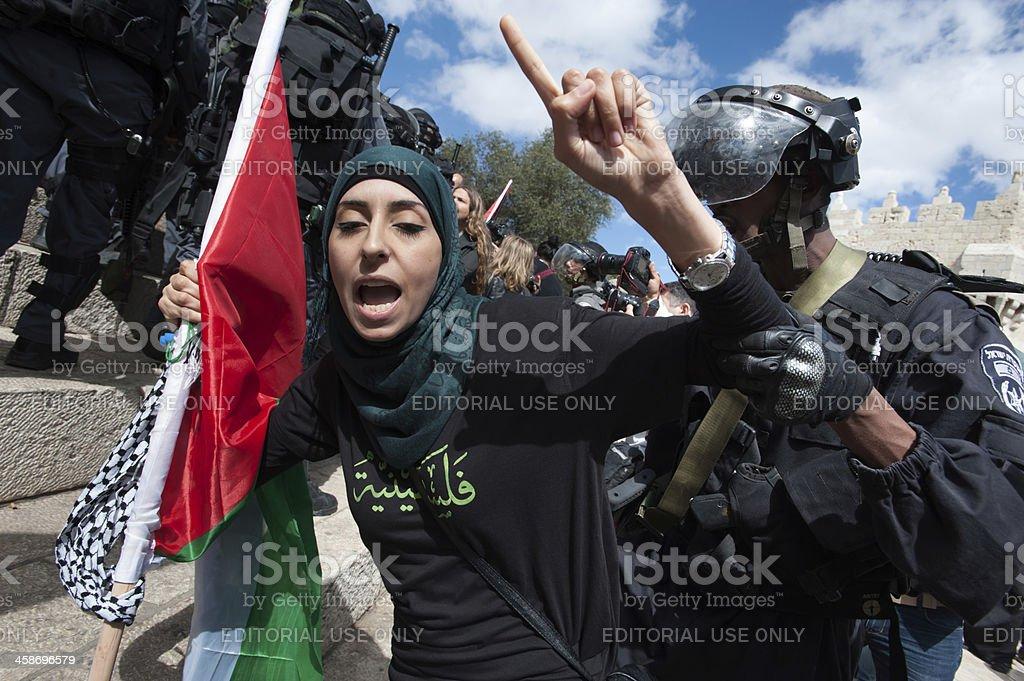 Israeli police arrest Palestinian woman stock photo
