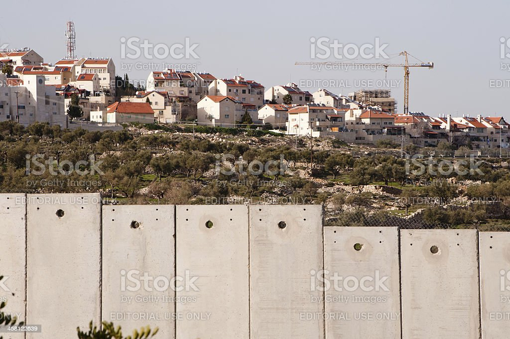 Israeli separation wall and settlement stock photo