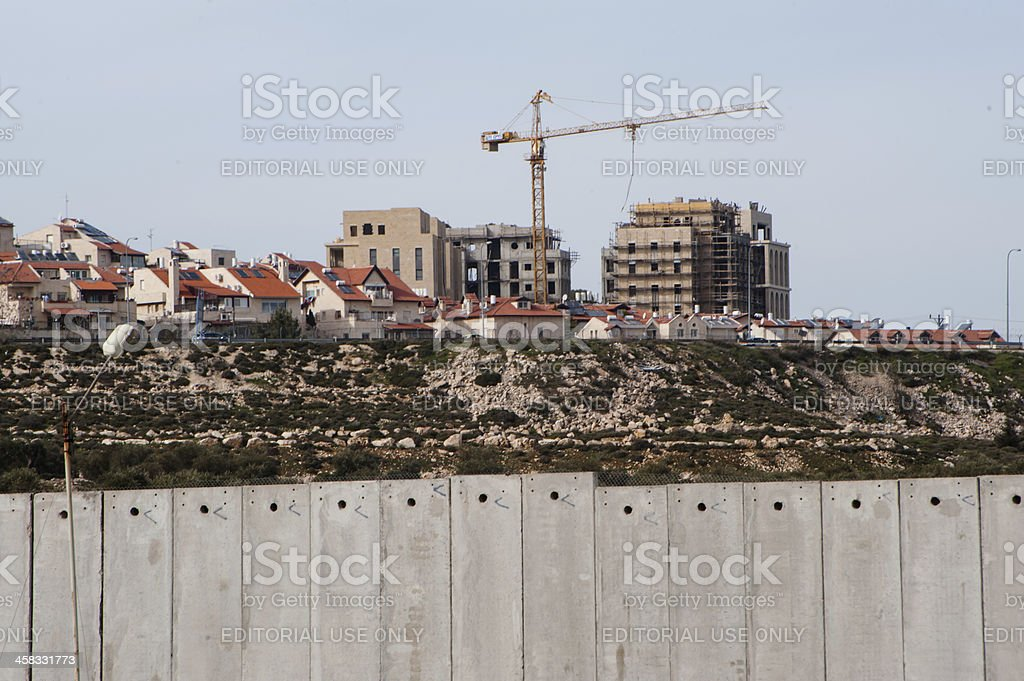 Israeli settlement construction and separation wall royalty-free stock photo