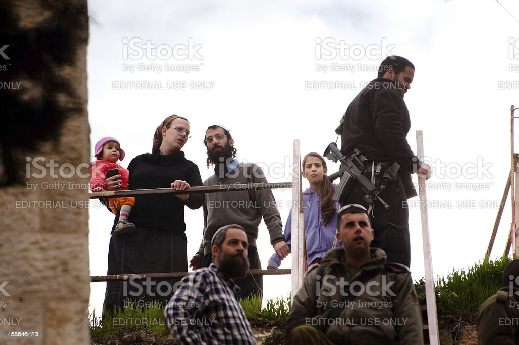 Israeli settlers and soldiers in Hebron stock photo