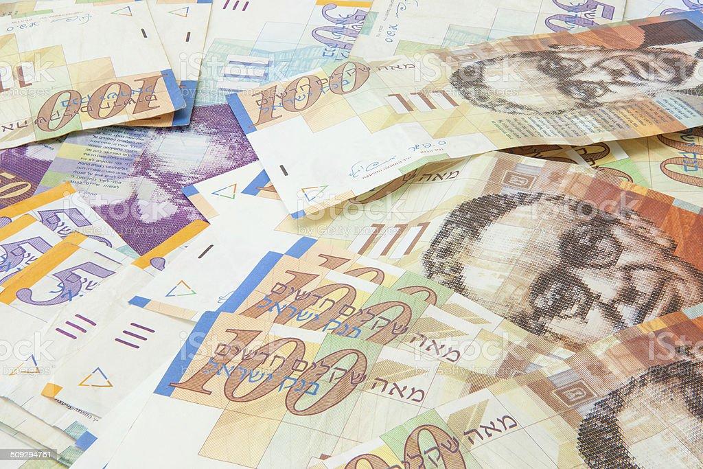 Israeli shekel notes background stock photo