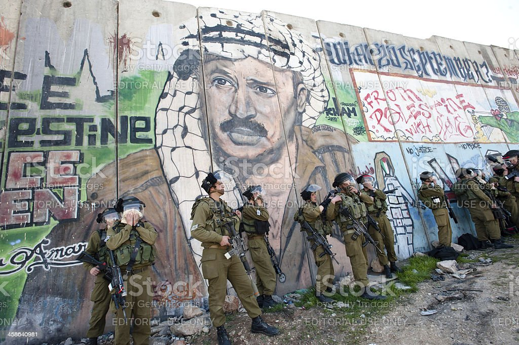 Israeli soldier affected by tear gas royalty-free stock photo