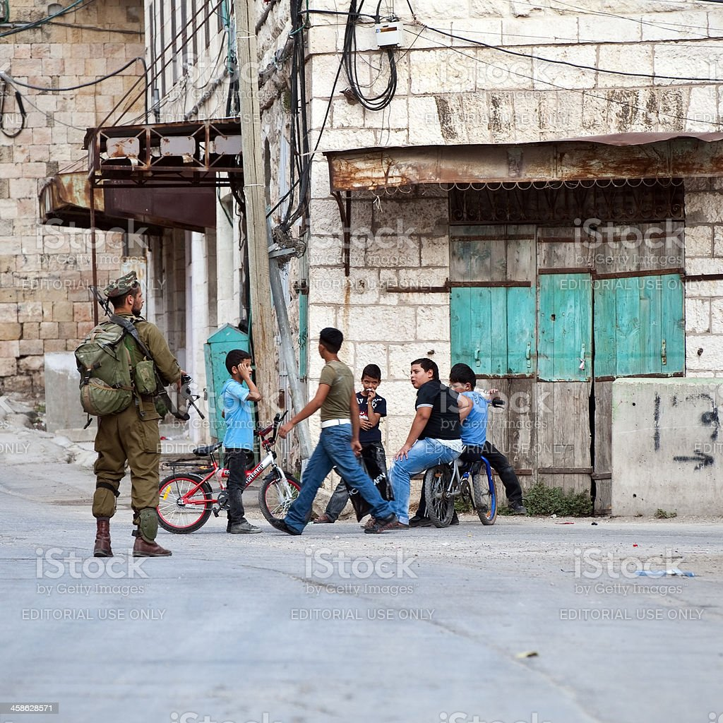 Israeli soldier and Palestinian children stock photo