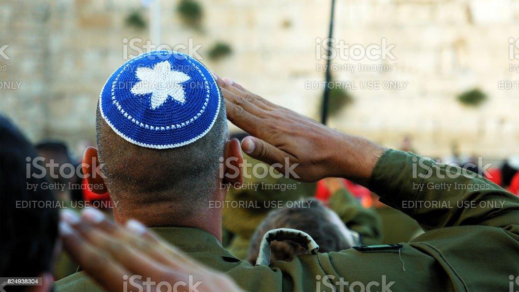 Israeli soldier military man saluting stock photo