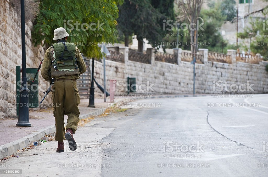 Israeli soldier on patrol in West Bank city of Hebron royalty-free stock photo