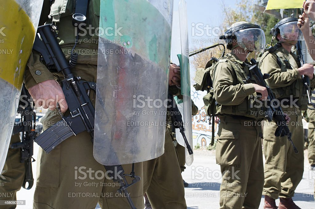 Israeli soldier with finger on trigger stock photo