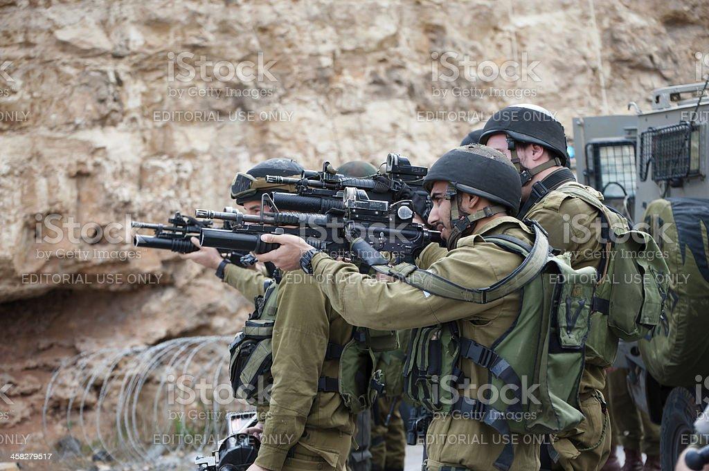 Israeli soldiers aim guns royalty-free stock photo