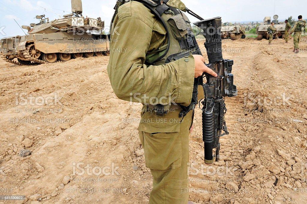 Israeli soldiers and Merkava tank stock photo