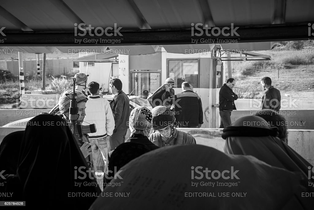 Israeli soldiers and Palestinian at Huwara checkpoin in West Bank stock photo