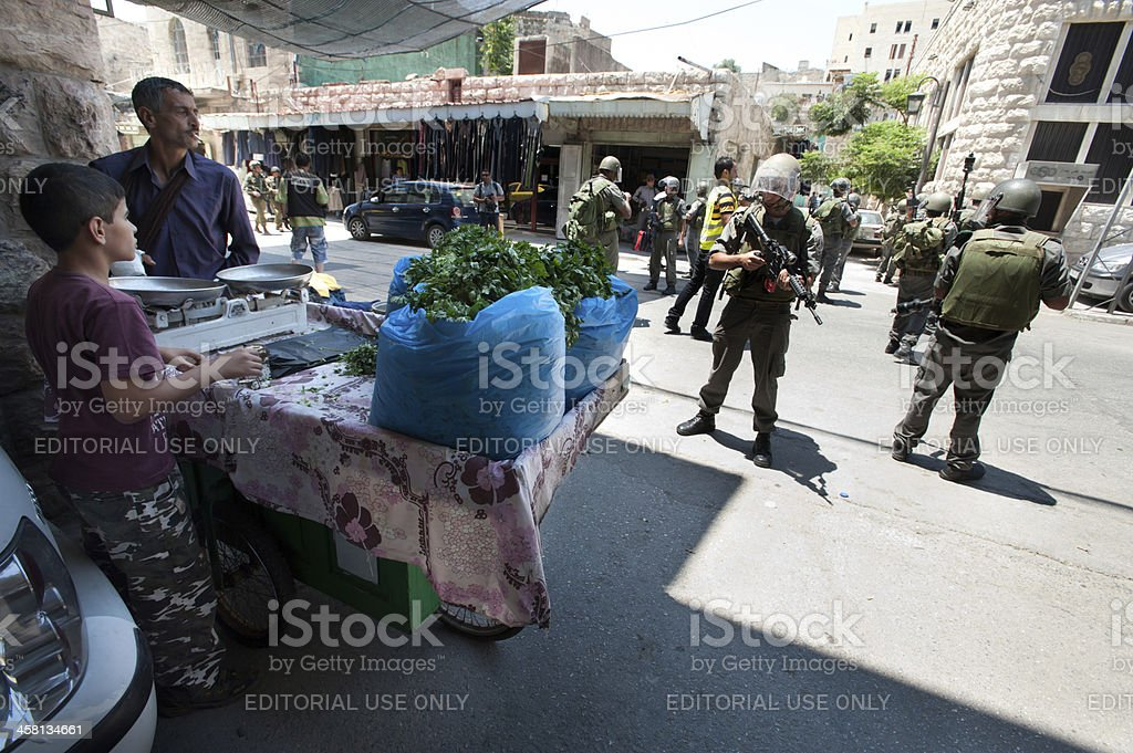 Israeli Soldiers and Palestinians stock photo