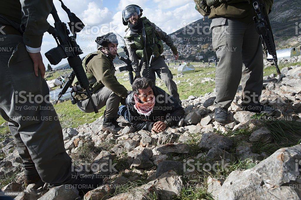 Israeli soldiers arrest Palestinian stock photo
