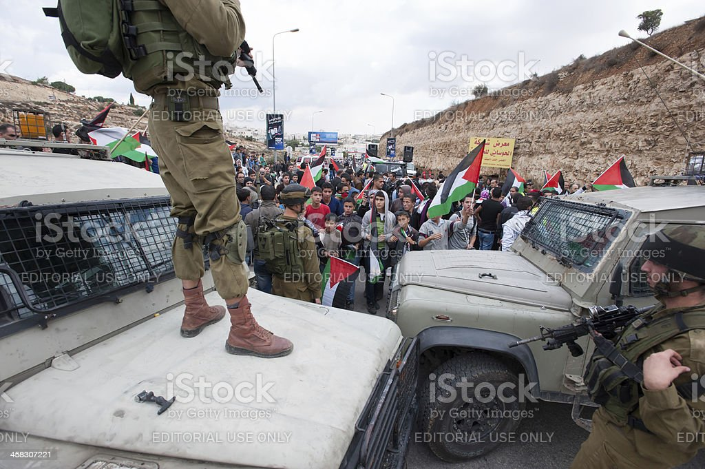 Israeli soldiers at Palestinian protest stock photo
