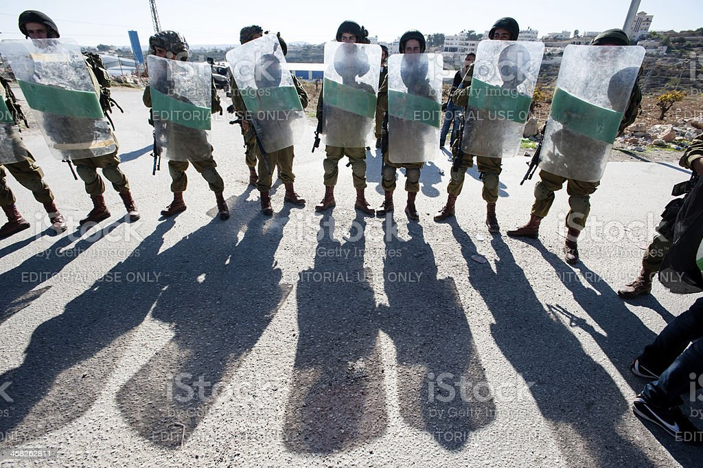 Israeli soldiers with riot shields stock photo